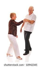 Senior couple jitterbugging.  Isolated on white.