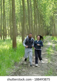 Senior couple jogging. Selective focus.