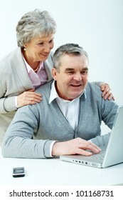 Senior couple learning how to use modern technology