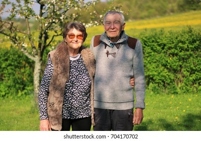 Senior couple in love standing hand in hand in the nature. Concept of active elderly people during retirement. Everyday joy lifestyle without age limitation.