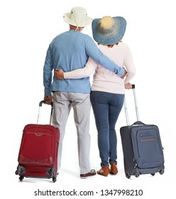 Senior couple with luggage.