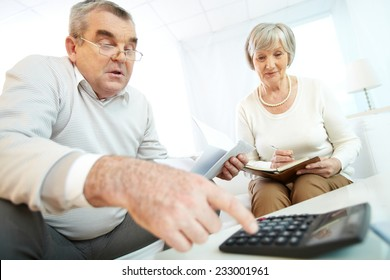Senior couple making calculations