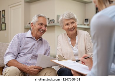 Senior couple meeting real estate agent at home. Old husband and wife with financial advisor for investment opportunities. Happy elderly man and woman listening to various investment plans.