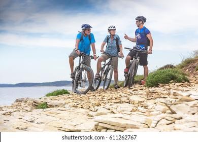 Senior couple on biketour with young bikeguide