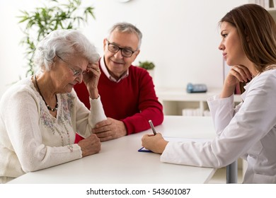 Senior couple on consultation with a doctor at clinic