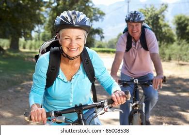 Senior couple on country bike ride