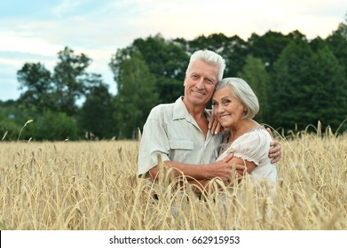 Senior couple on field of wheat