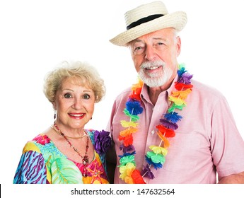 Senior couple on tropical vacation, dressed for summertime.  Isolated on white.