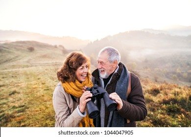 Senior couple on a walk in an autumn nature.