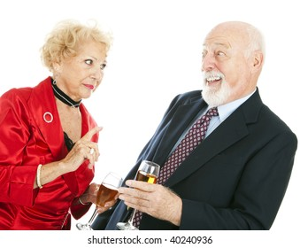 Senior couple at a party.  The husband is drunk and the wife is angry at him.  Isolated on white.