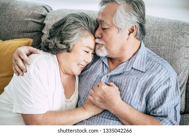 Senior couple Playing together at living room