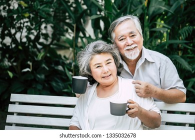 Senior couple Playing together at park