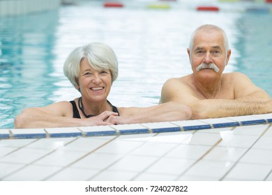 senior couple in pool