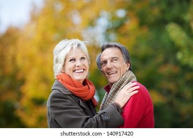 A Senior Couple Posing in the garden