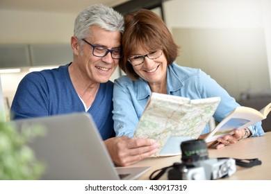 Senior couple preparing vacation trip