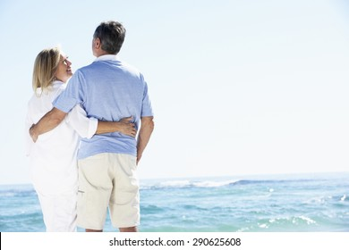 Senior Couple Relaxing By Ocean