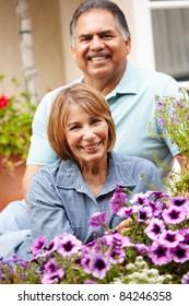 Senior couple relaxing in garden