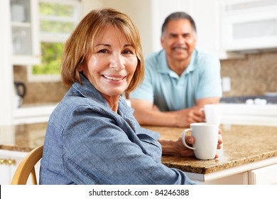 Senior couple relaxing in kitchen