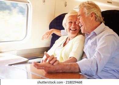 Senior Couple Relaxing On Train Journey