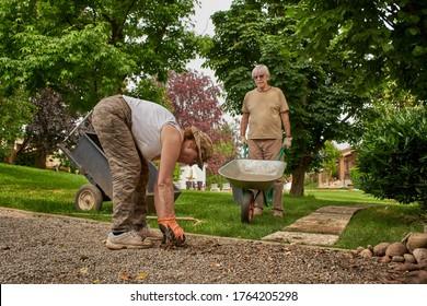 Senior couple in retirement working in the garden