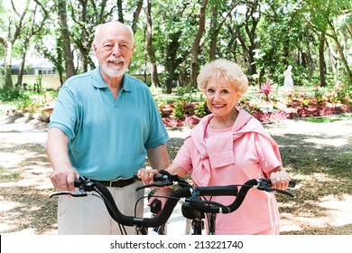 Senior couple riding bicycles to stay in shape.