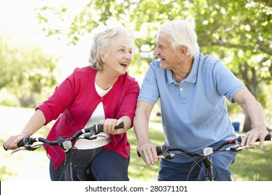 Senior couple riding bikes