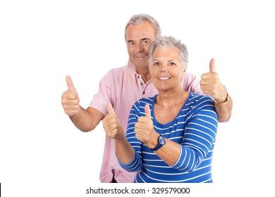 Senior couple showing ok thumbs up isolated on white background