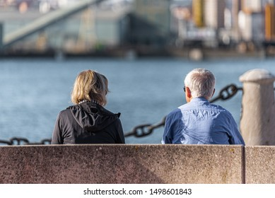 senior couple sitting on bench in the pier  , Old age and relationships concept
