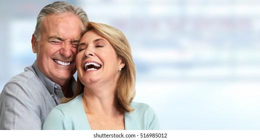 Senior couple smiling. - Shutterstock ID 516985012