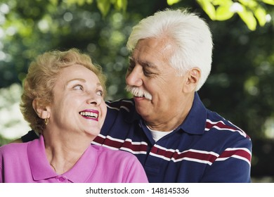 Senior couple smiling at each other