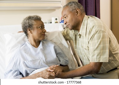 Senior Couple Standing In Hospital Together