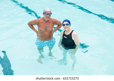 Senior couple standing together in swimming pool