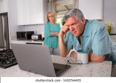 Senior couple stressed from receiving bad news in email, possibly health care, retirement funds, mortgage, or investments