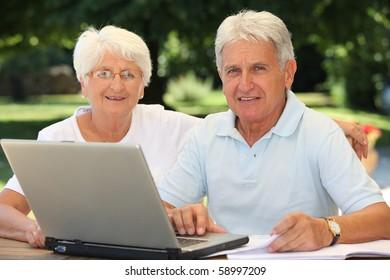 Senior couple surfing on internet