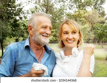 senior couple together enjoying romantic walk in golden park, Happy life
