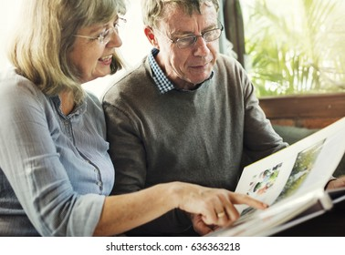 Senior couple together reading a book