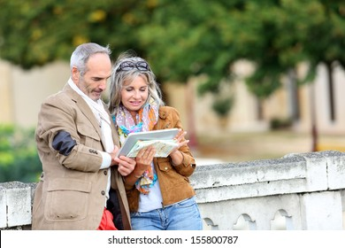 Senior couple of tourists on a trip