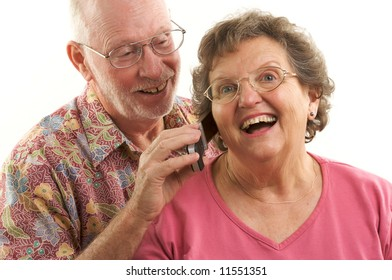 Senior Couple using a cell phone.