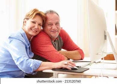 Senior Couple Using Computer At Home