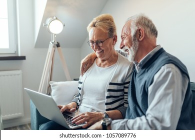 Senior couple using a laptop computer