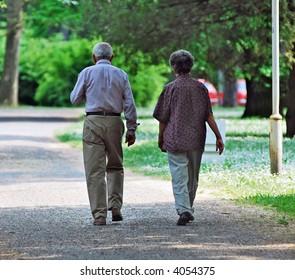 Senior couple walking at the park