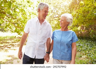 Senior couple walking together in the countryside