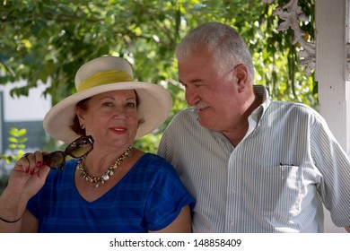 Senior couple, woman looking at camera her husband looking at her with love and trust