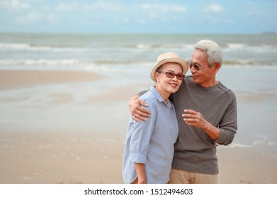 Senior couples embrace the sunrise beach, plan life insurance with the concept of happy retirement.