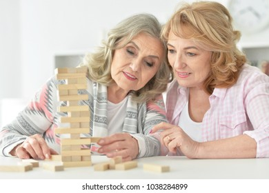 senior couples playing with wooden blocks