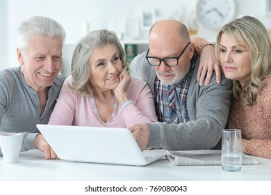 senior couples reading newspaper