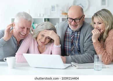 senior couples using laptop