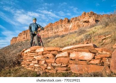 senior cyclist with a fat bike on Blue Sky Trail near Fort Collins, Colorado, fall scenery