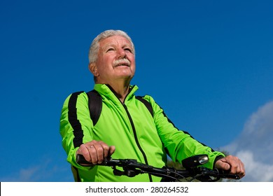Senior cyclist in front of the blue sky