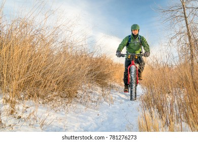 senior cyclist is riding a fat bike in winter, cold day in Colorado